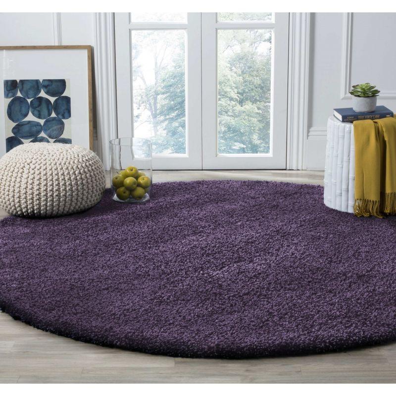 Dywan nowoczesny okrągły shaggy jednolity - fioletowy